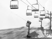 Chair lift and snow making machines - black and white Stock Image