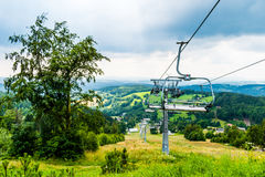 Chair lift on summer Stock Photos