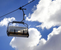 Chair-lift and sunlight sky Stock Image