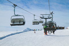 Chair Lift with Three Skiers Stock Photos