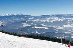 Chair lift on the top of ski slope of skiing park Kubinska Hola in winter. Stock Image