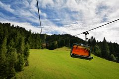Chair lift transportation in Sankt Ulrich am Pillersee to Jakobskreuz Cross, Royalty Free Stock Images