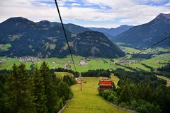 Chair lift transportation in Sankt Ulrich am Pillersee to Jakobskreuz Cross, Royalty Free Stock Image