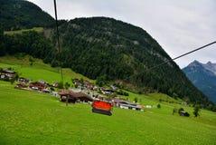 Chair lift transportation in Sankt Ulrich am Pillersee to Jakobskreuz Cross,. Chair lift transportation in  Sankt Ulrich am Pillersee to Jakobskreuz Cross, Alps Stock Images