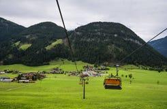 Chair lift transportation in Sankt Ulrich am Pillersee to Jakobskreuz Cross,. Chair lift transportation in  Sankt Ulrich am Pillersee to Jakobskreuz Cross, Alps Stock Image