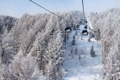 Chair lift in winter mountains Royalty Free Stock Image