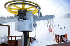 Chair lifts on foot of ski slope at Austrian Alps Royalty Free Stock Image