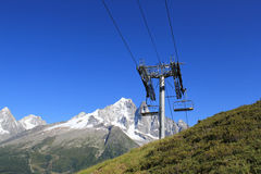 Chair lifts  in front of the Mont-Blanc Stock Image