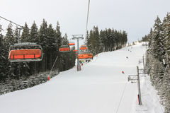 Chair lifts in Jasna Ski Resort, Slovakia. Orange Chair lifts in Jasna, best Ski Resort in Slovakia stock image