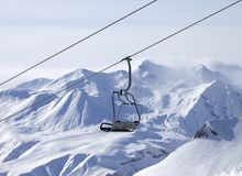 Chair lifts and off-piste slope in fog Royalty Free Stock Photo