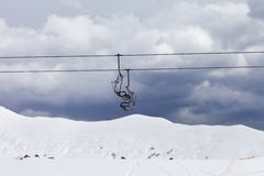 Chair lifts and off-piste slope at gray day Stock Images