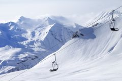 Chair lifts and off-piste slope in haze Royalty Free Stock Photos