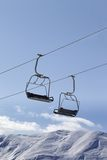 Chair lifts and off piste slope at nice day Stock Photo