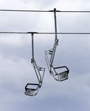 Chair-lifts and overcast sky Stock Photography