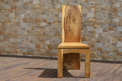 Chair made of solid wood on a stone background Royalty Free Stock Images