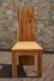 Chair made of solid wood on a stone background Royalty Free Stock Image