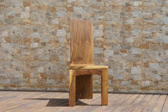 Chair made of solid wood on a stone background Stock Images