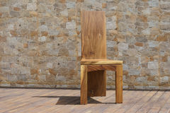 Chair made of solid wood on a stone background Royalty Free Stock Photography