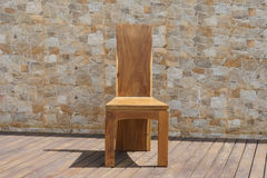 Chair made of solid wood on a stone background Stock Photography
