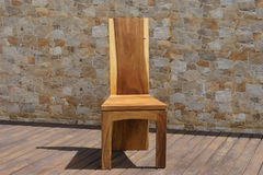 Chair made of solid wood on a stone background Royalty Free Stock Photo
