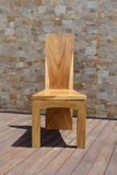 Chair made of solid wood on a stone background Royalty Free Stock Photos