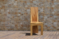 Chair made of solid wood on a stone background Stock Photos
