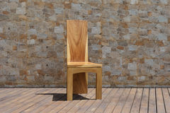 Chair made of solid wood on a stone background Stock Image