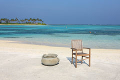 Chair on Maldives beach Stock Images