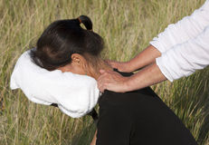 Chair massage. In the dunes on the island Ameland, the Netherlands royalty free stock photography