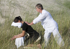 Chair massage. In the dunes on the island Ameland, the Netherlands royalty free stock photos