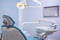 Chair and medical equipments at dental clinic Royalty Free Stock Photography