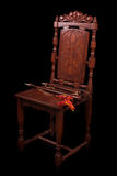 Chair with medieval wood winds. Old chair with medieval wood winds Royalty Free Stock Photography