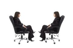 Chair with mirror image. Businesswoman sitting on the chair with mirror image isolated in white background Stock Photography
