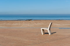 Chair near the beach. A chair with a view on the beach Royalty Free Stock Images