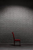 Chair near brick wall Stock Photo