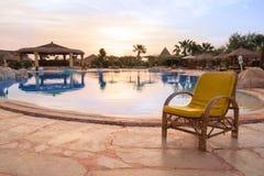Chair near the pool. The chair near the pool Stock Image