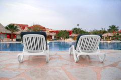 Chair near the pool. The pool at the hotel are 2 trestle Stock Photography