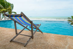 Chair near the pool and sea Stock Image