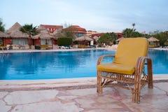 Chair near the pool. Yellow armchair near the pool Stock Photo