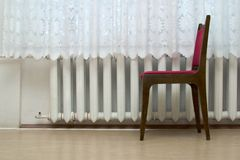 Chair near window. With white curtain Royalty Free Stock Photos