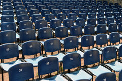 Chair row - numbers. Many rows of blue, numbered chairs Royalty Free Stock Images