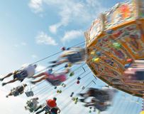 Chair-O-Planes at the fair. People enjoying the ride in a classic Chair-O-Planes at the fair stock images