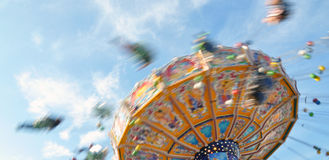 Chair-O-Planes at the fair. People enjoying their ride in a classic Chair-O-Planes at the fair royalty free stock photography