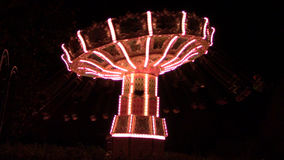 Swing ride at night stock footage