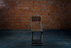 Chair and old brick wall Royalty Free Stock Photo