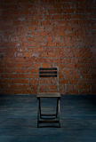 Chair and old brick wall Royalty Free Stock Images