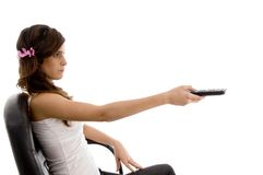 chair operating remote sitting woman Στοκ εικόνες με δικαίωμα ελεύθερης χρήσης
