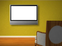 Chair opposite green wall with lcd tv Stock Photo