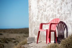 Chair outside patagonia lighthouse in valdes peninsula Royalty Free Stock Images