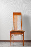 Chair over wall royalty free stock photography